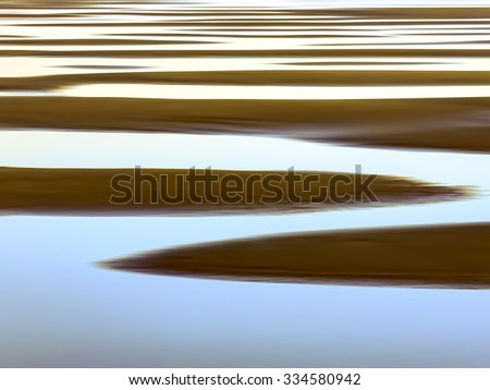 Pattern of rising tide: Luminous abstract of sandy beach striped with seawater along Pacific coast of Olympic Peninsula in Washington, USA (one of a series) - stock photo