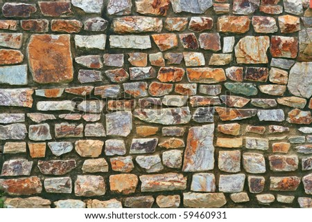 Pattern of Traditional Stone Brick Wall made of fragment stones in irregular shapes - stock photo