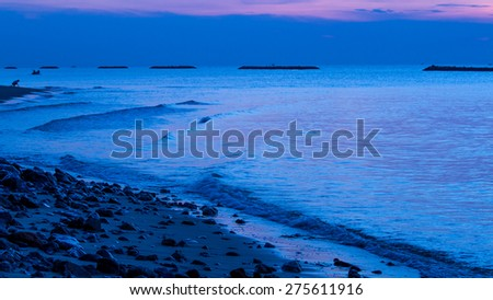 Pattern of wave in blue and indigo smooth sea  at The Break of Dawn. - stock photo