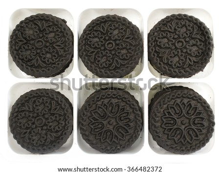 Pattern/Texture of Chocolate cookies with cream filling in pack, top view - stock photo