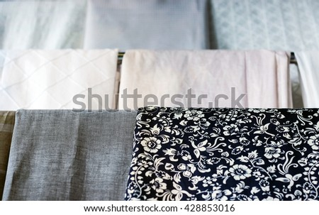 patterned cloth hanging on shelf