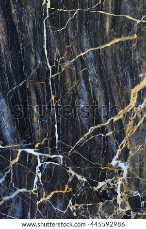 Patterned natural of dark gray marble background texture for interior design. Abstract background.