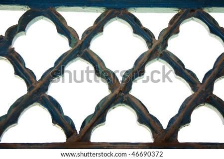 patterned old rustic iron lattice against white background - stock photo