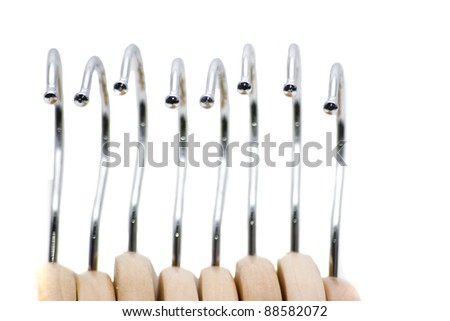 patterned view of chrome and wooden hangers li - stock photo