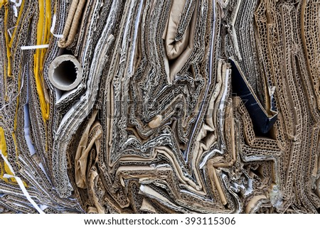 Patterns made of compressed box-board at the recycling center - stock photo