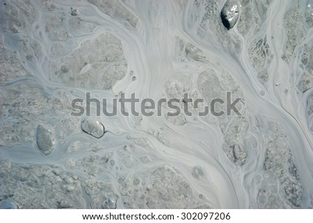 Patterns of silt in a stream of mud. - stock photo