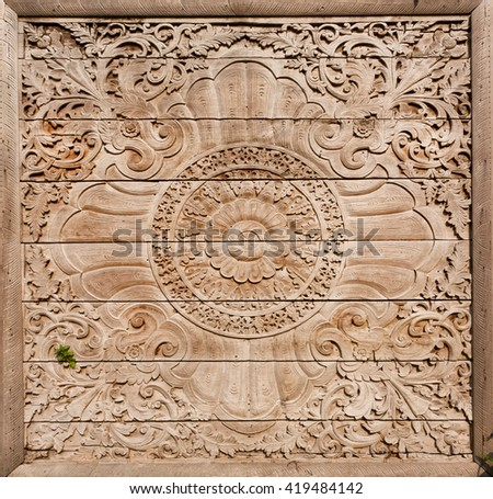 Patterns on ancient wooden gate with symbolic carvings, Artistic background style  - stock photo