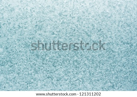 Patterns on glass in the frosty winter day. Christmas background - stock photo