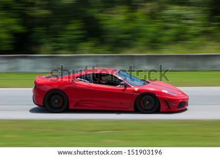 PATTYA, THAILAND-AUG.18 : Unidentified driver operated Ferrari f430 during the Thailand Super Series 2013 Round 3-4 at Bira International Circuit on August 18, 2013 in Pattaya, Thailand - stock photo