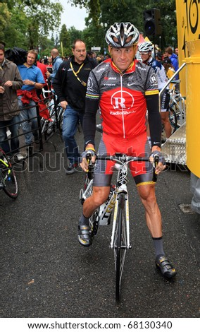 PAU, FRANCE - JULY 22:  Cyclist Lance Armstrong gives an interview before the start of the 17th stage of Tour de France 2010 on July 22, 2010 in Pau, France. - stock photo