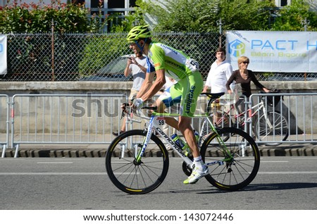 "PAU,  FRANCE - JULY 16: Vanotti Alessandro (a participant of the 99th cycle race ""Tour de France"") runs in the street of PAU, FRANCE on the 16th JULY 2012."