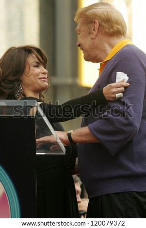 Paula Abdul and Jerry Buss at the Ceremony Honoring Los Angeles Lakers Owner Jerry Buss with the 2,323rd star on the Hollywood Walk of Fame. Hollywood Boulevard, Hollywood, CA. 10-30-06 - stock photo