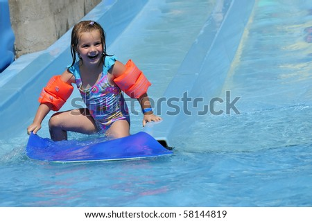 Paula's first surfing - stock photo
