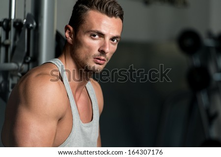 Pause After Effort. Portrait Of A Young Muscular Sporty Fit Caucasian Man Resting At The Bench - stock photo