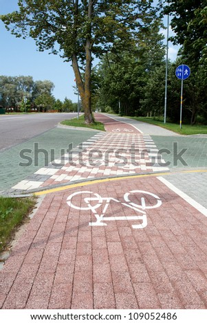 paved bicycle path crosses the street