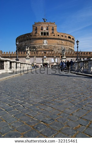 Paved bridge leading to Castel Sant'Angelo in Rome. - stock photo
