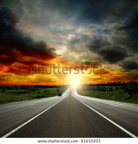 paved road between the hills - stock photo