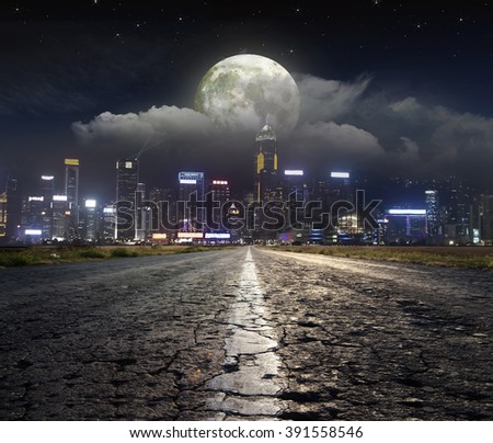 Paved road in the moonlight - stock photo
