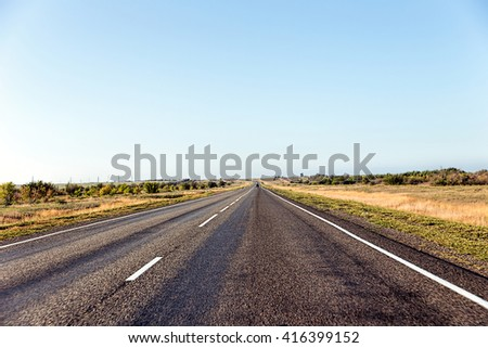 Paved road in the steppe - stock photo