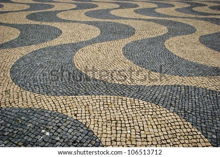 Paved sidewalk with wave pattern - stock photo