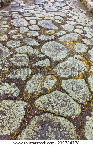 Paved street at the ancient Roman city of Pompei, which was destroyed and buried during the eruption of Mount Vesuvius in 79 AD  - stock photo