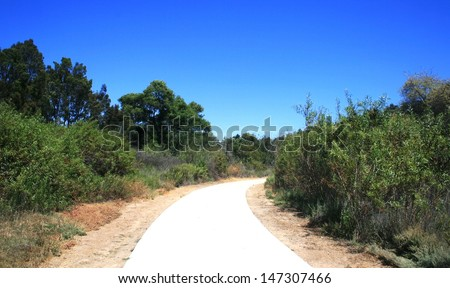 Paved walk way through a suburban nature park, Irvine, CA - stock photo