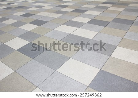 pavement background, concrete tiles in shades of grey - stock photo