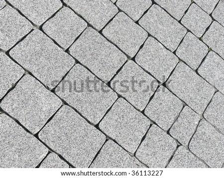 Pavement blocks closeup. More pavements in my port. - stock photo