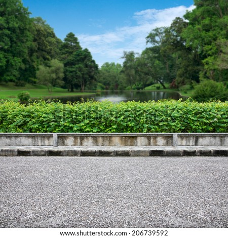 Pavement view of beautiful park on blue sky - stock photo