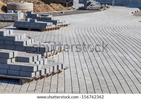 Pavement with cobblestones under construction. - stock photo