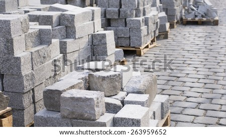 Pavement with cobblestones under construction - stock photo