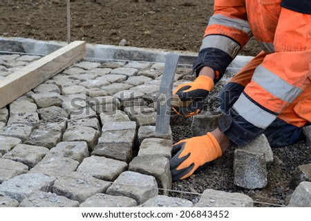 Mason Building Pavement Hands Yellow Gloves Stock Photo