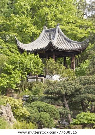Pavilion between trees - stock photo