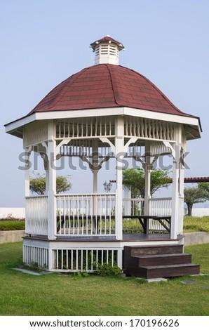 Pavilion in the garden. - stock photo