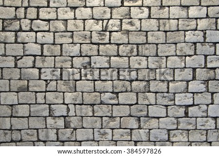 Paving blocks made of small tiles of regular shape - stock photo
