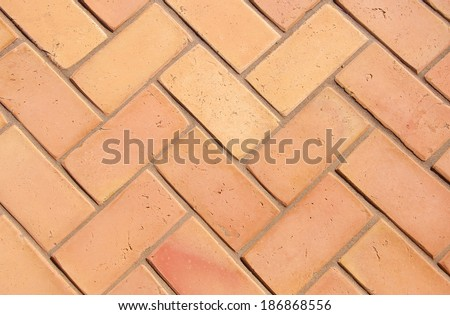 Paving slabs in the form of bricks. Background. Texture. - stock photo