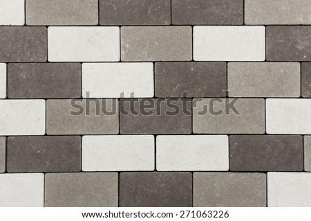 Paving stone brick . Black , grey and white - stock photo