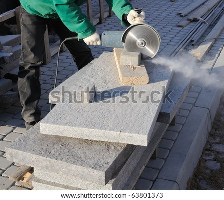 Paving stone saws working with power tools - stock photo