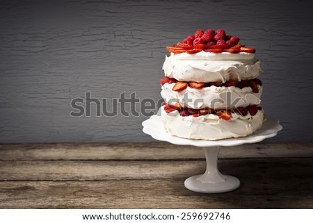 Pavlova: A Cake Made From Layers of Meringue, Whipped Cream, and Fresh Berries