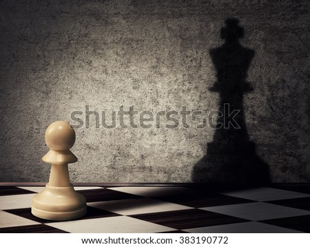 pawn chess piece casting a shadow of a king on a concrete wall. Business aspirations and leadership concept. Magical transformation - stock photo