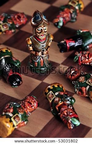 Pawns of an ecuadorian chess set between Spaniards and Incas - stock photo