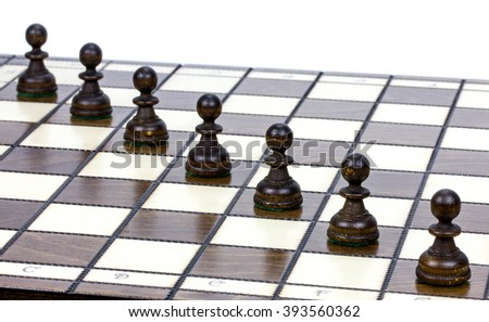 pawns on a chessboard - stock photo