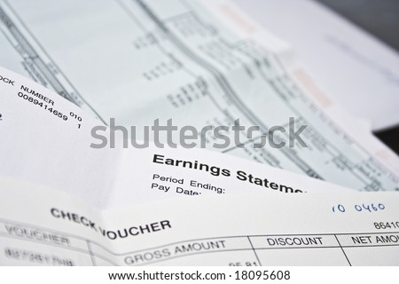 pay checks and earnings statement - stock photo