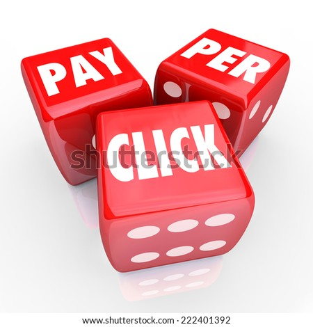 Pay Per Click words on three red dice to illustrate PPC advertising or marketing strategy to drive traffic to your website - stock photo