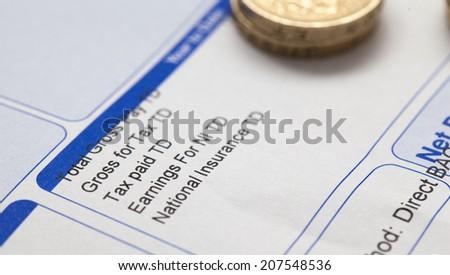 Pay slip close up macro shot - stock photo