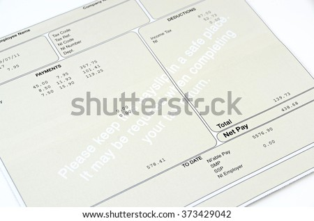 Pay slip close up macro shot.