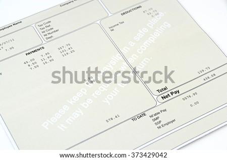 Pay slip close up macro shot.  - stock photo