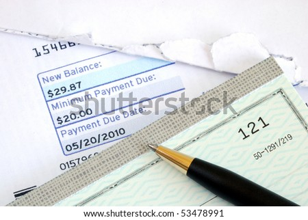 Pay the bill on time with a check - stock photo