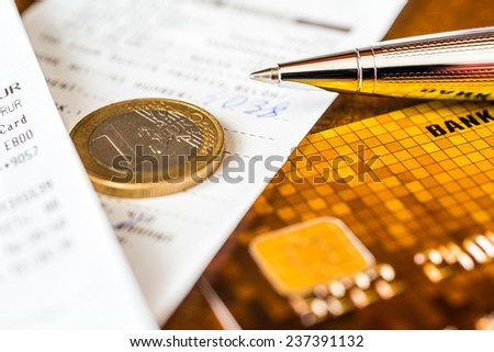 Pay the bills, credit card with pen and money on the table - stock photo
