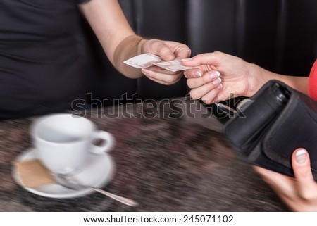 Paying the bill at the coffee shop - stock photo